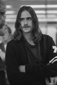 James Taylor Cross-Armed Stare