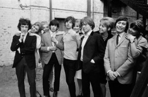 The Rolling Stones With A Group Of Ladies