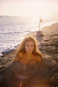 Raquel Welch Buried in Sand