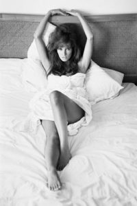 Raquel Welch Reclined in White