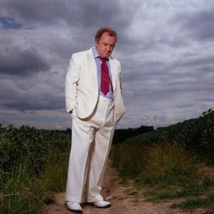Peter Langan White Suit Sky